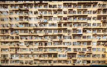 Apartment building with air conditioners