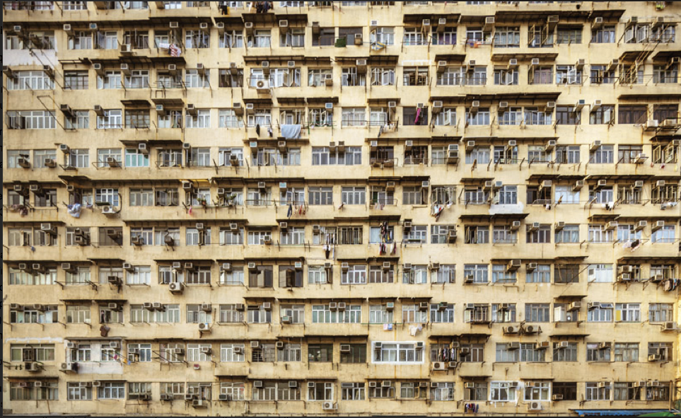 Energy-hungry air conditioners in a Hong Kong apartment building.